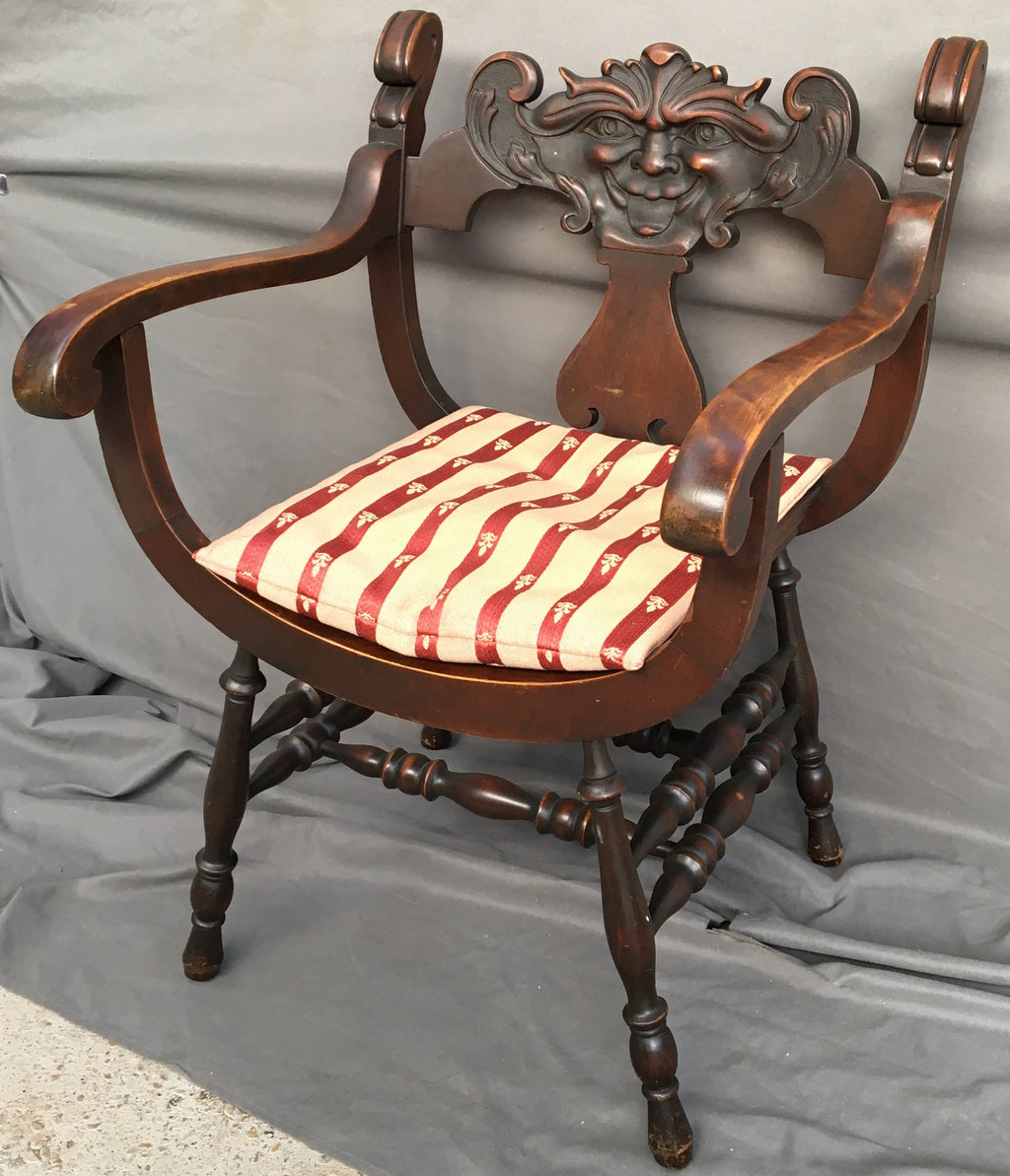 1910 MAHOGANY SAVANAROLA MUSIC CHAIR WITH FACE CARVED IN BACK