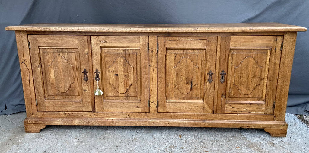 LONG RUSTIC OAK SIDEBOARD WITH SHAPED PANELS