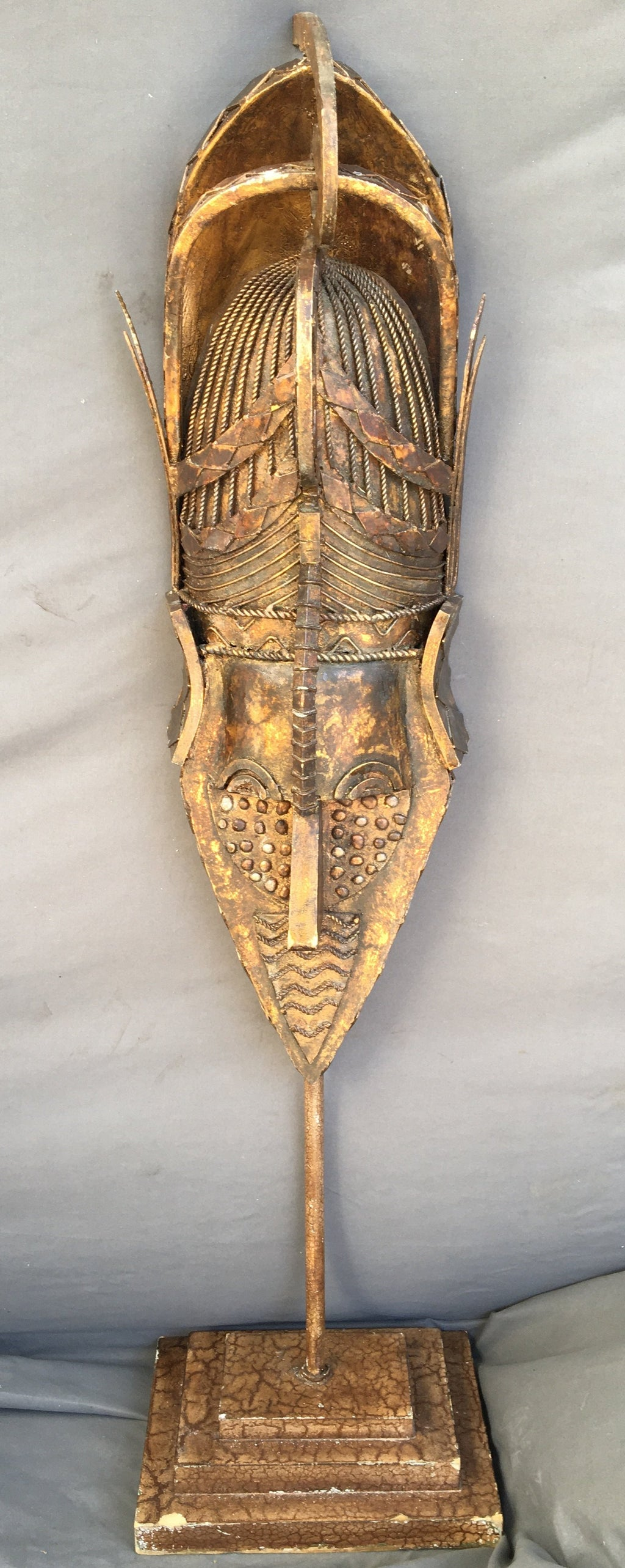 GOLD METAL MASK ON STAND
