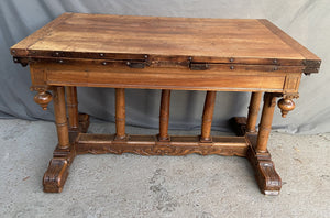 FRENCH RENAISSANCE REVIVAL WALNUT TABLE WITH COLUMN SUPPORTS AND SCROLL ACCENTS