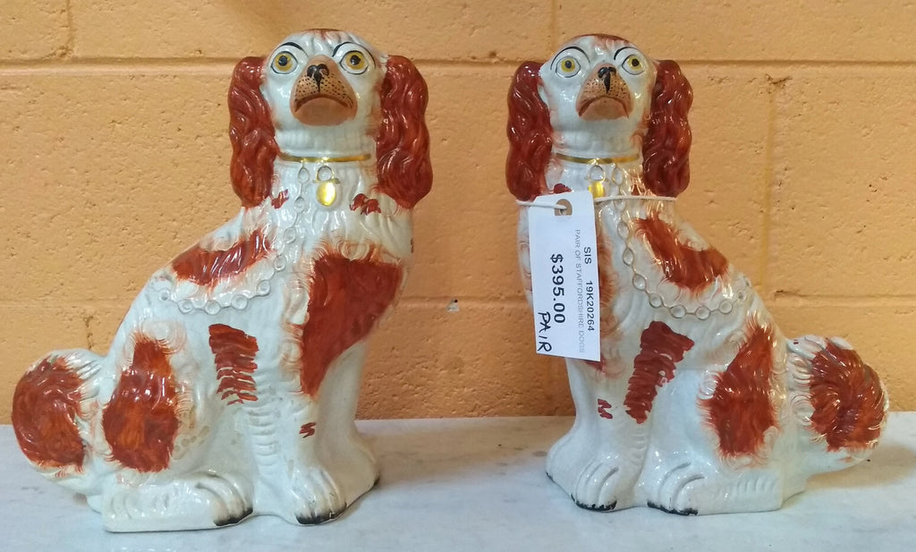 PAIR OF ORANGE AND WHITE ENGLISH STAFFORDSHIRE DOGS
