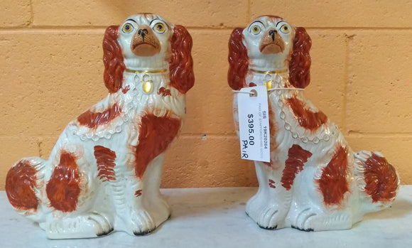 PAIR OF ORANGE AND WHITE STAFFORDSHIRE DOGS