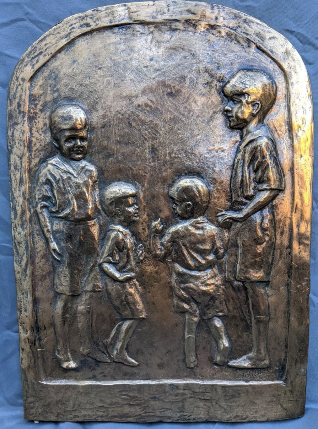 SIGNED BRASS PLAQUE OF 4 BOYS