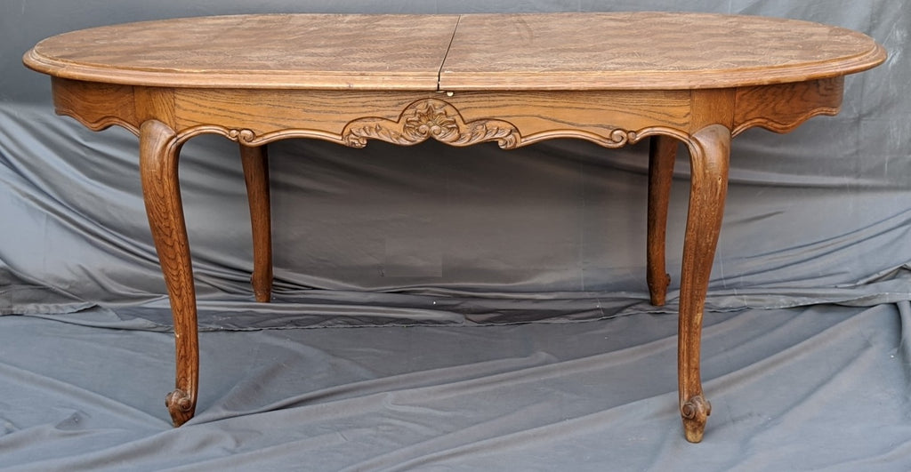 NARROW OVAL OAK DINING TABLE WITH POP UP LEAF