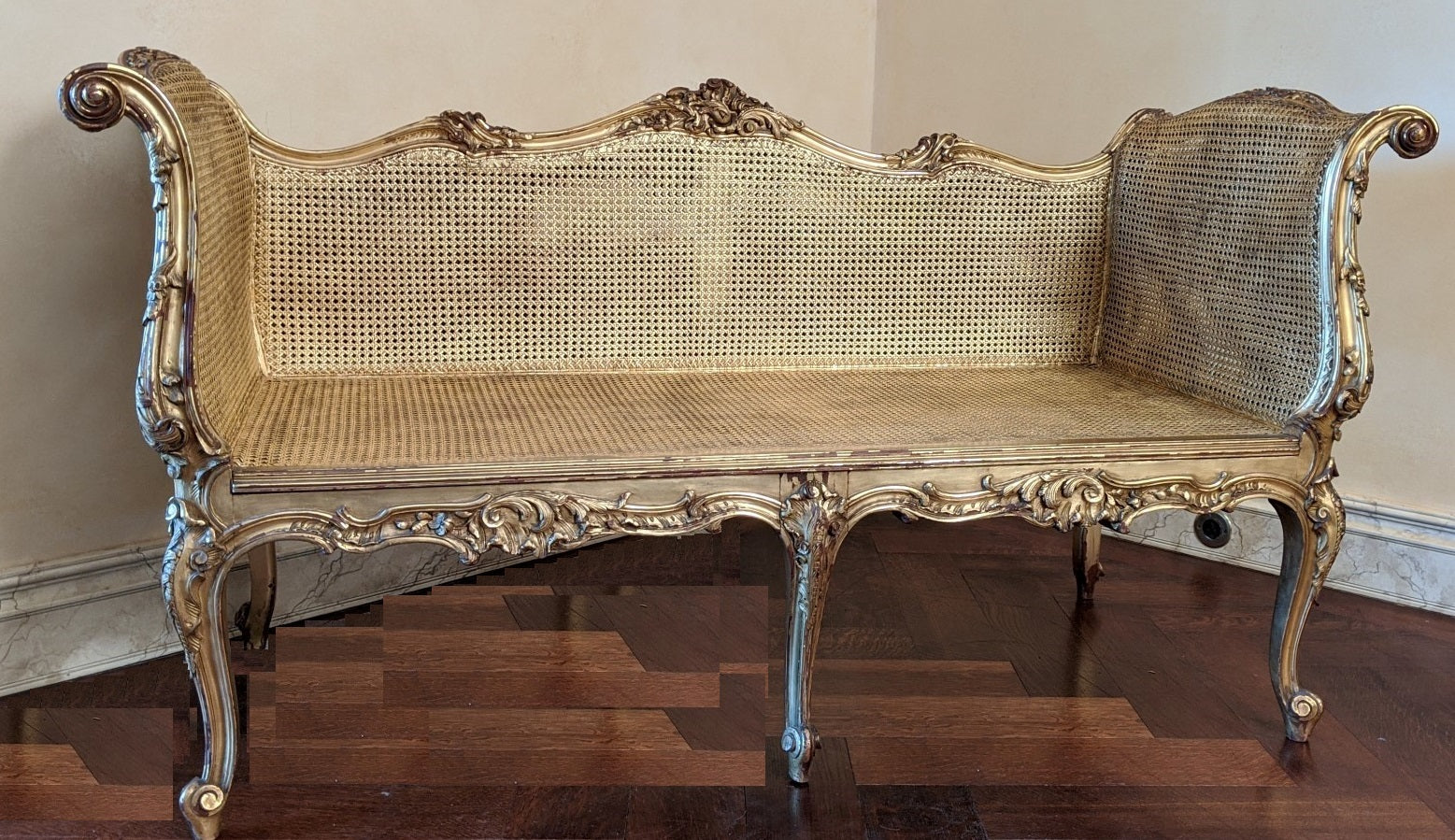LOUIS XV CARVED GILTWOOD AND CANE SETTE