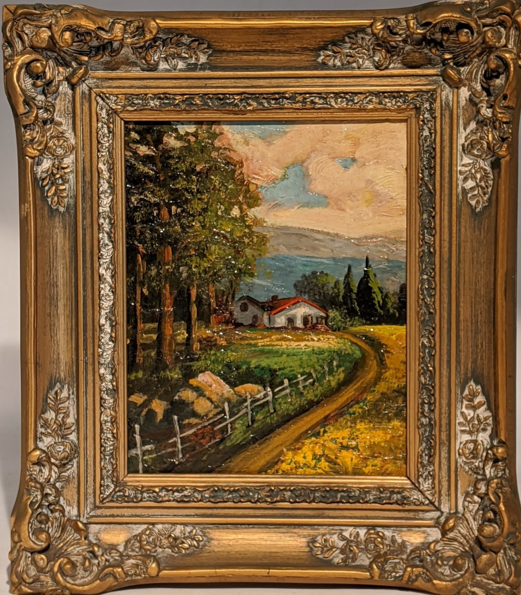 SMALL ORNATELY FRAMED OIL PAINTING OF RED ROOF HOUSE WITH FENCE AND TREES
