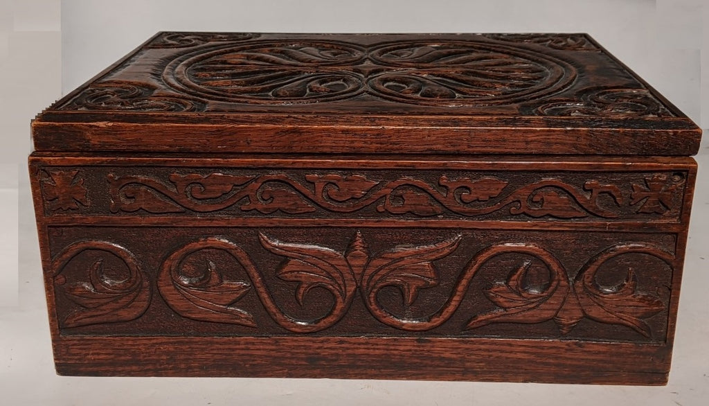 EARLY CARVED BOX WITH IRON HINGES