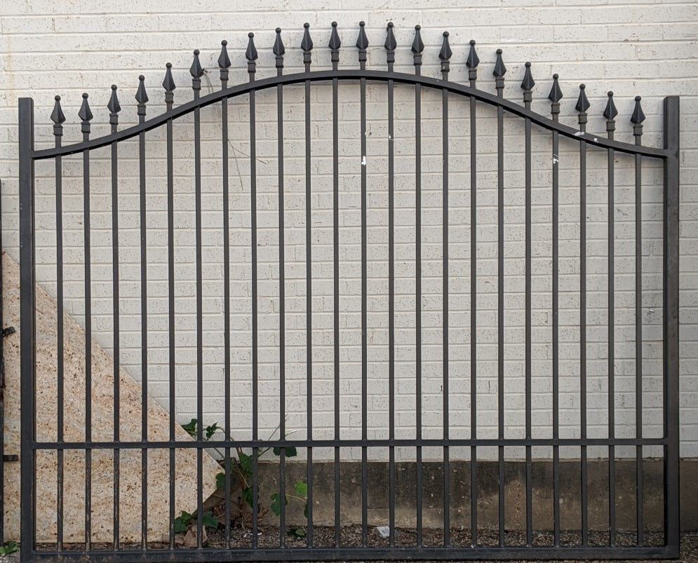 TALL ARCHED IRON GATE WITH FINIALS