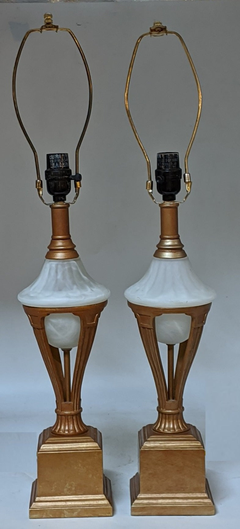 PAIR OF GOLD METAL LAMPS WITH GLASS ORBS