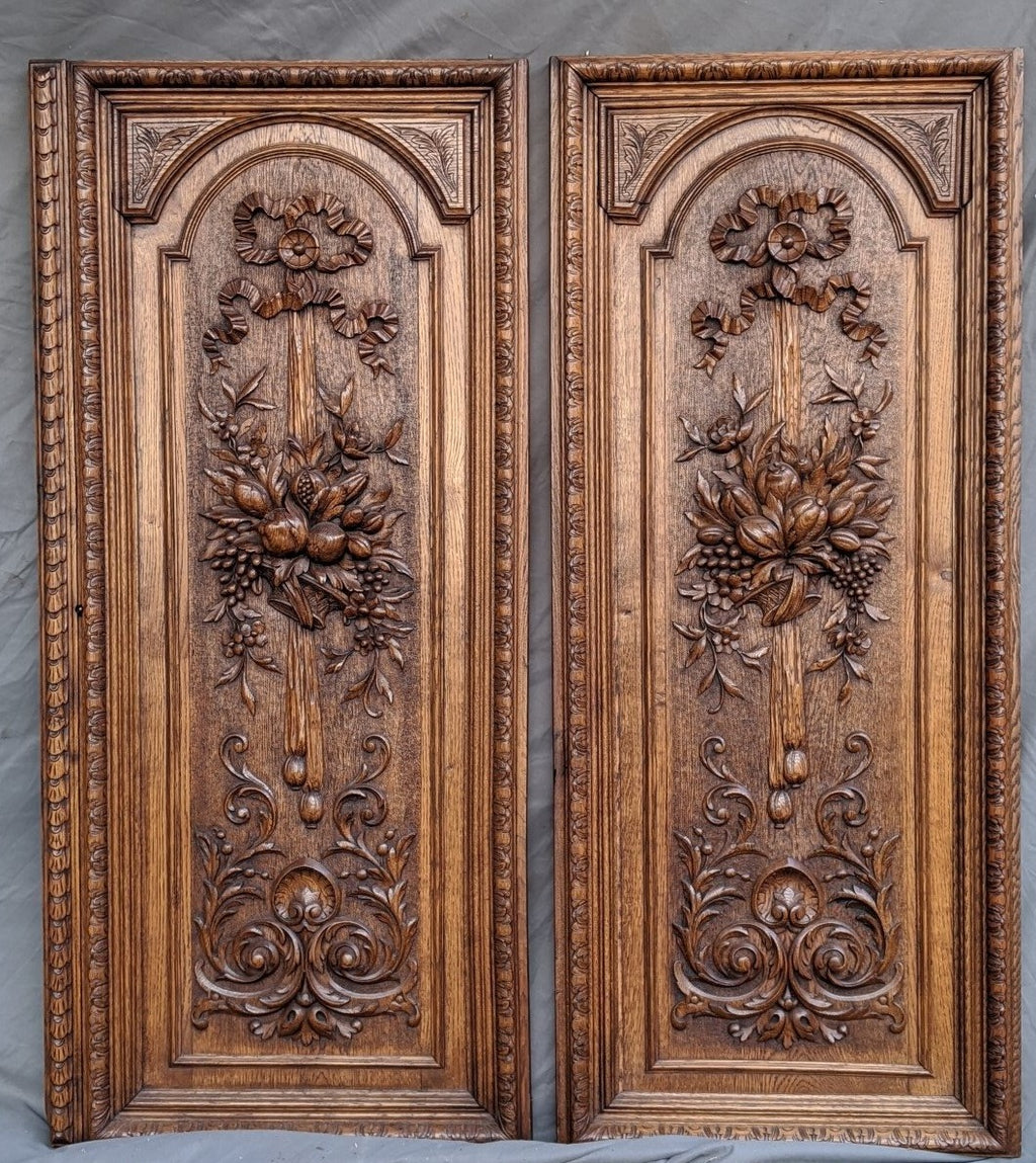 PAIR OF TALL CARVED FRENCH OAK DOOR PANELS