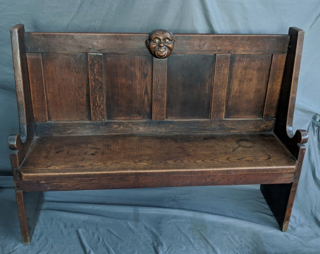 OAK HALL BENCH WITH CARVED FACE