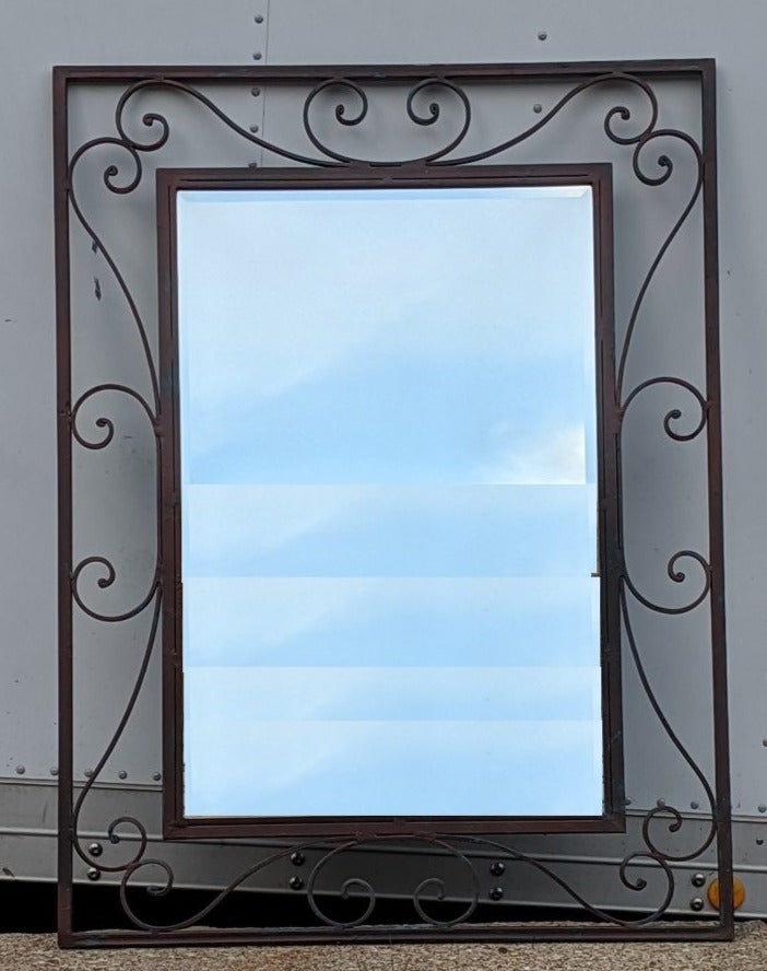 RECTANGULAR. BEVELED IRON MIRROR WITH SCROLL DESIGN
