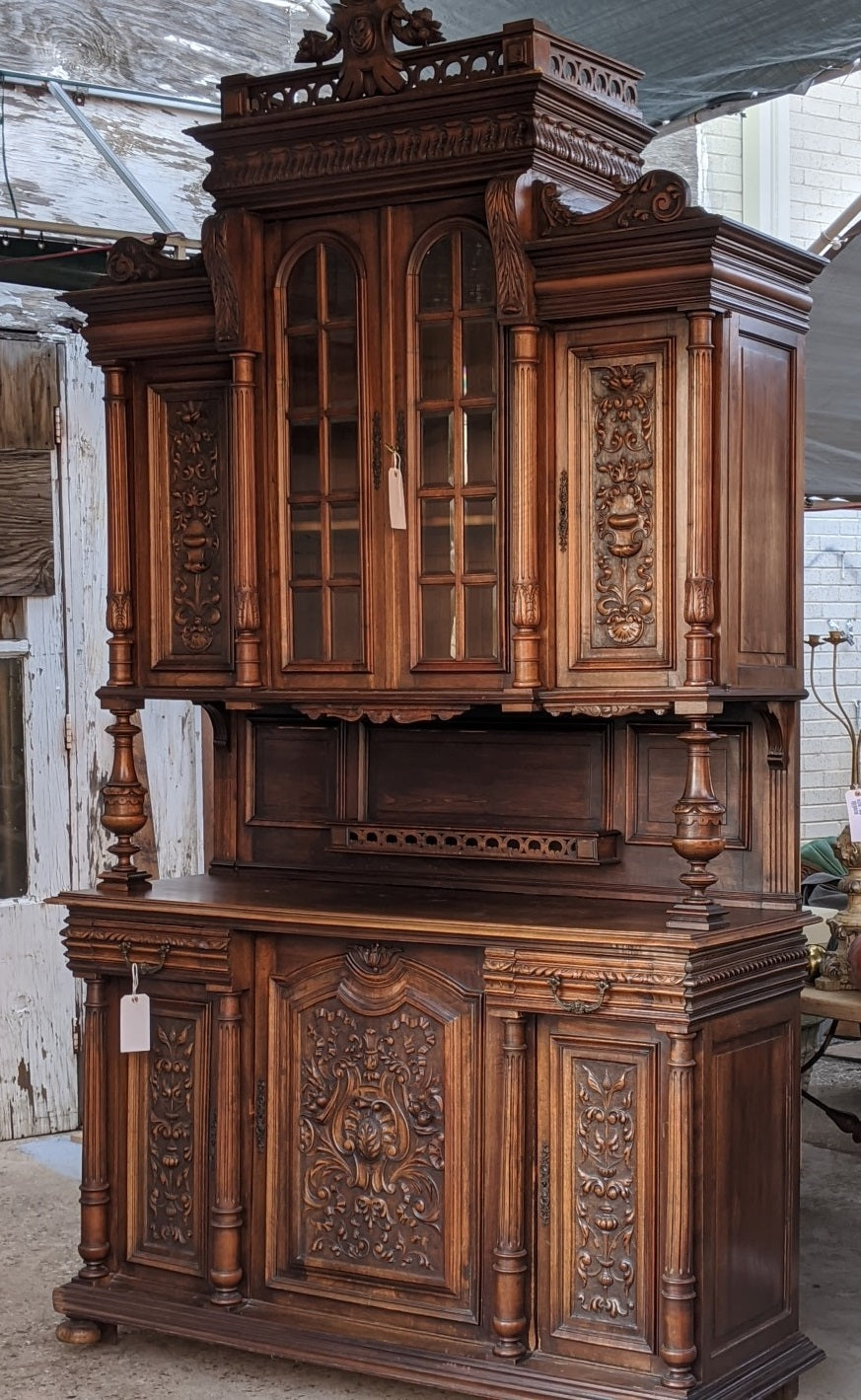 TALL HENRY II CARVED HUNTBOARD WITH BEVELED GLASS DOOR