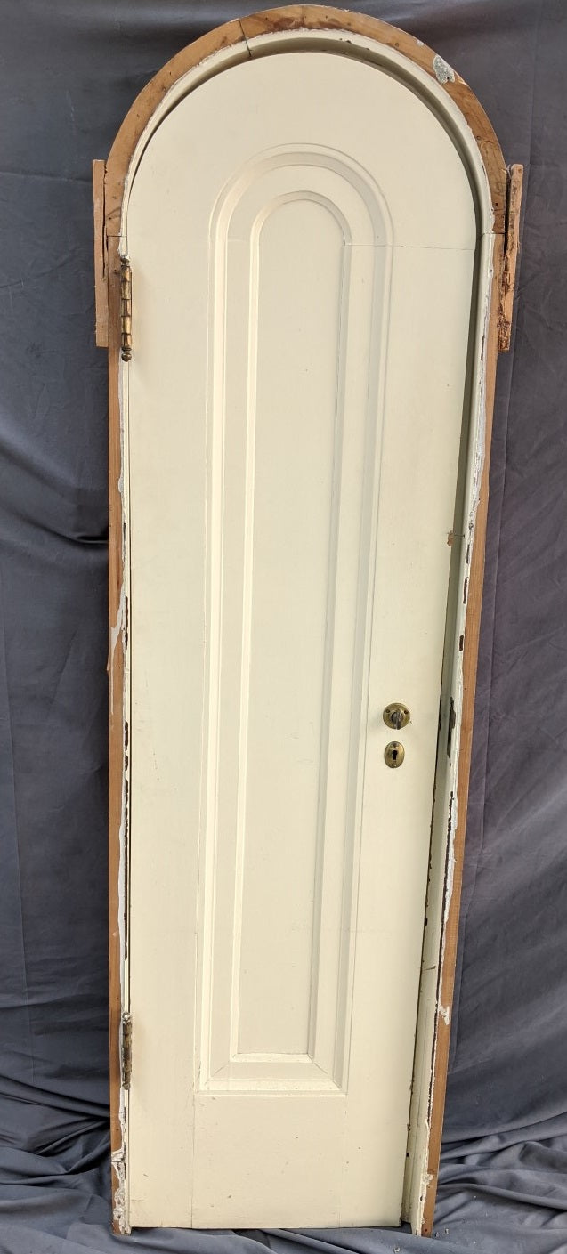 NARROW ARCHED DOOR IN FRAME PAINTED
