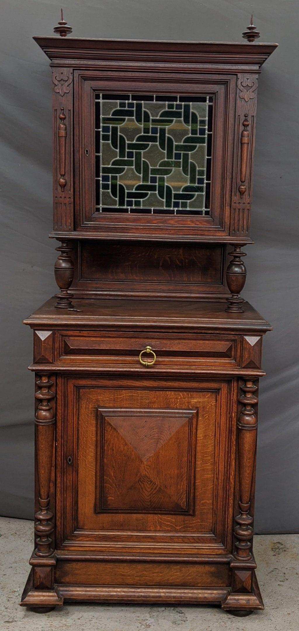 NARROW RUSTIC OAK BUFFET WITH STAINED GLASS TOP DOOR