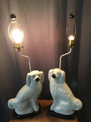 PAIR OF STAFFORDSHIRE WHITE DOG LAMPS
