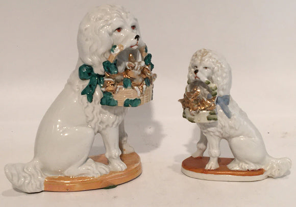 PAIR ANTIQUE DOGS WITH BASKETS -ONE LARGE, ONE SMALL