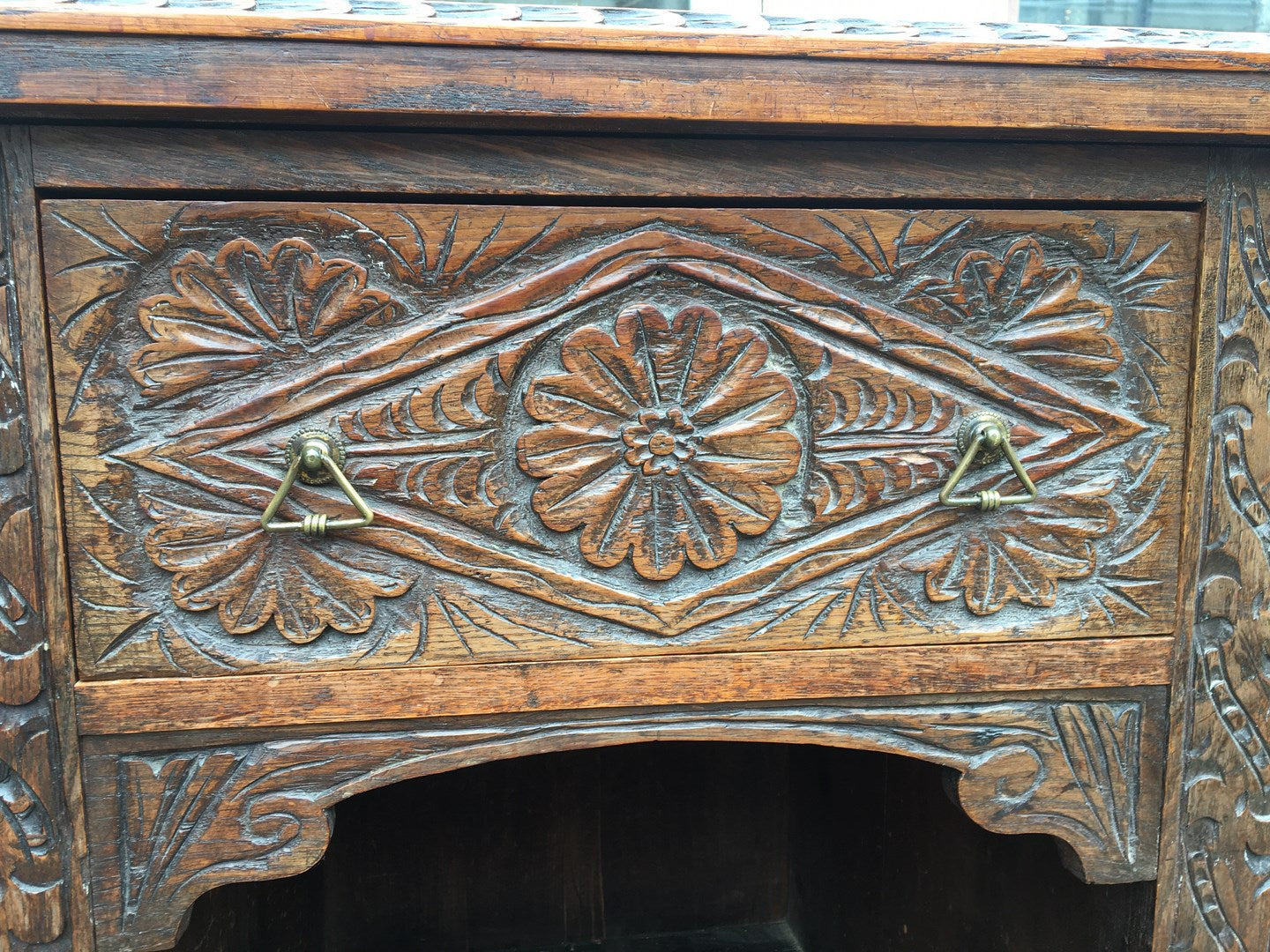 LOW CHIP CARVED ENGLISH OAK SIDEBOARD WITH FRET CARVED TOP