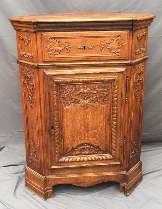 CARVED OAK CORNER CABINET