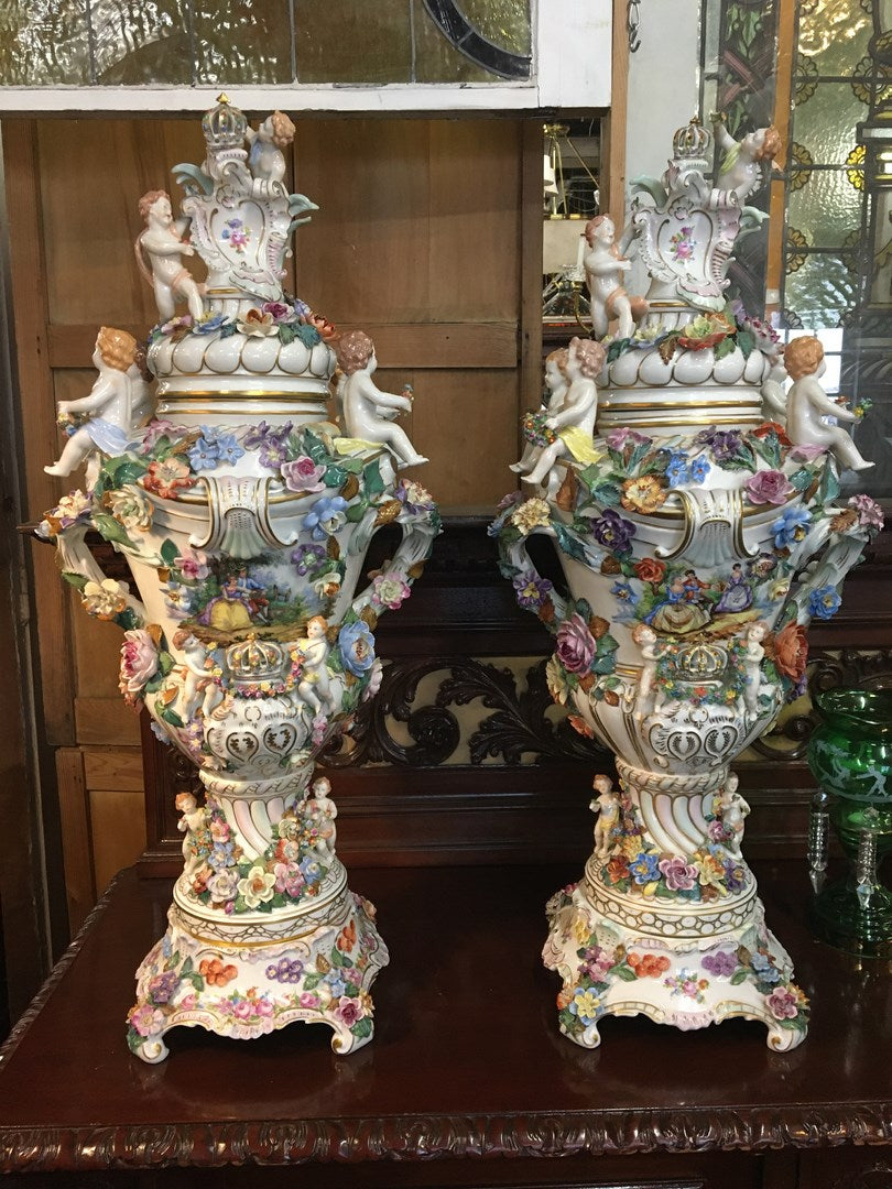 PAIR OF HUGE DRESDEN URNS WITH FLOWERS AND CHERIBUM