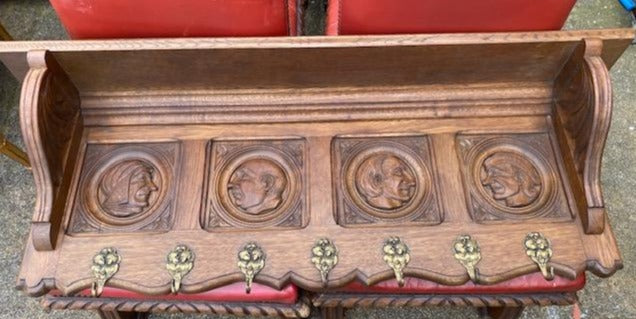 CARVED OAK WALL SHELF WITH PORTRAITS IN PROFILE