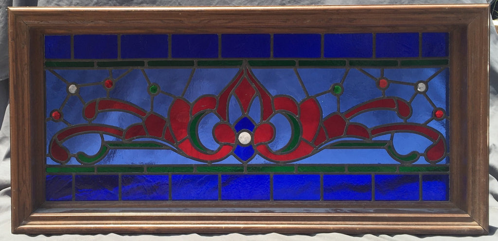 LONG RED AND BLUE STAINED GLASS TRANSOM WINDOW WITH RONDELL