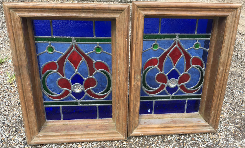 PAIR OF SMALL RED AND BLUE STAINED GLASS WINDOWS WITH RONDELL