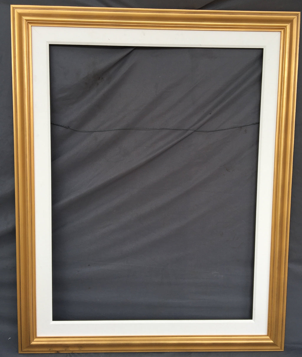 LARGE GOLD FRAME WITH THICK WHITE LINER