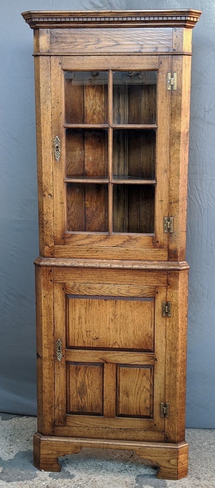 PEGGED OAK CORNER CUPBOARD