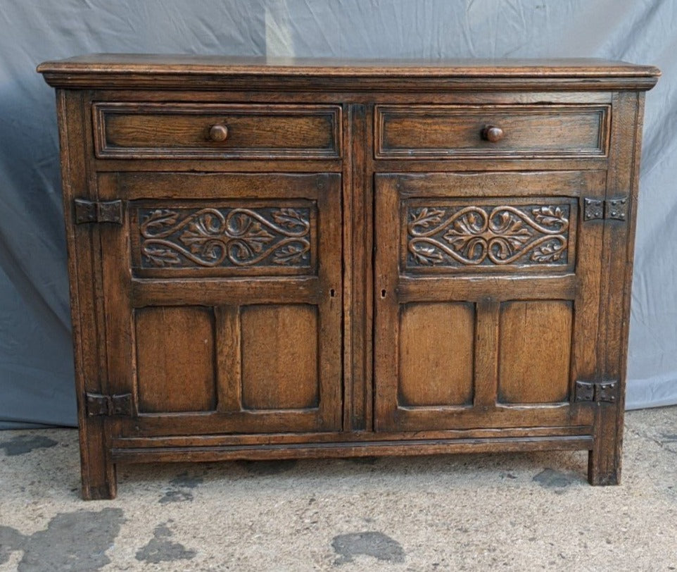 FLEUR DE LIS CARVED OAK PANEL AND PEGGED SIDEBOARD