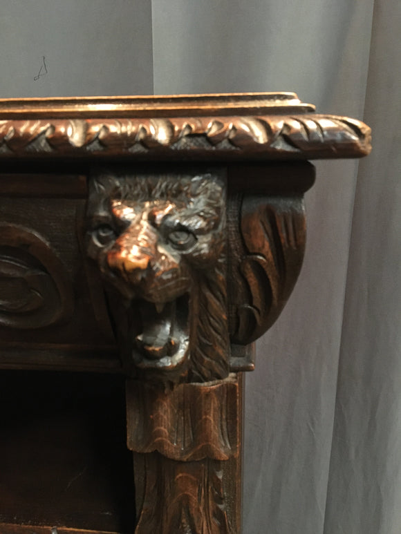 FRENCH OAK CARVED GRIFFIN HEAD BOOKCASE
