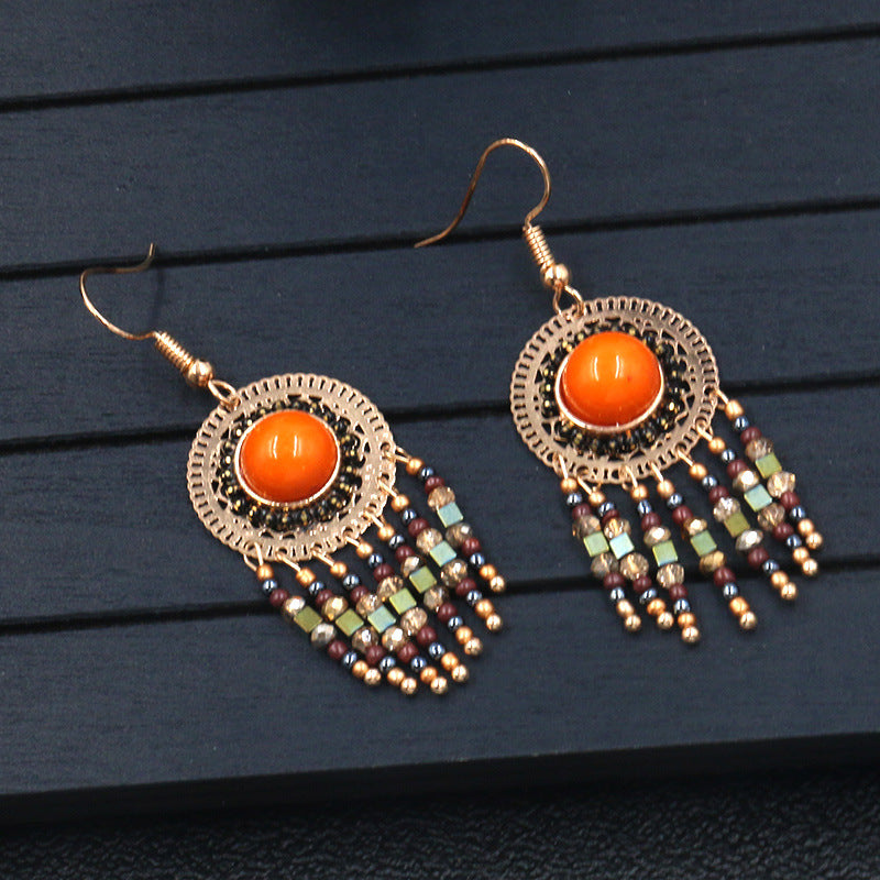 Hot fashion round openwork with turquoise stone crystal tassel Earrings Wholesale - Zebrant