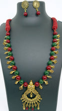 Load image into Gallery viewer, Maroon and Green beads with gold spacers and large gold pendant - Inspired Creations