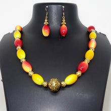 Load image into Gallery viewer, Red and Yellow with large ball pendant - Inspired Creations