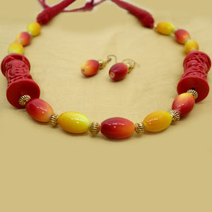 Red and Yellow with large charms - Inspired Creations
