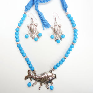Elegant Silver pisces and sky blue beads - Inspired Creations