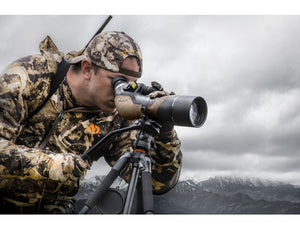Hunter looking through Burris Signature HD Spotting Scope