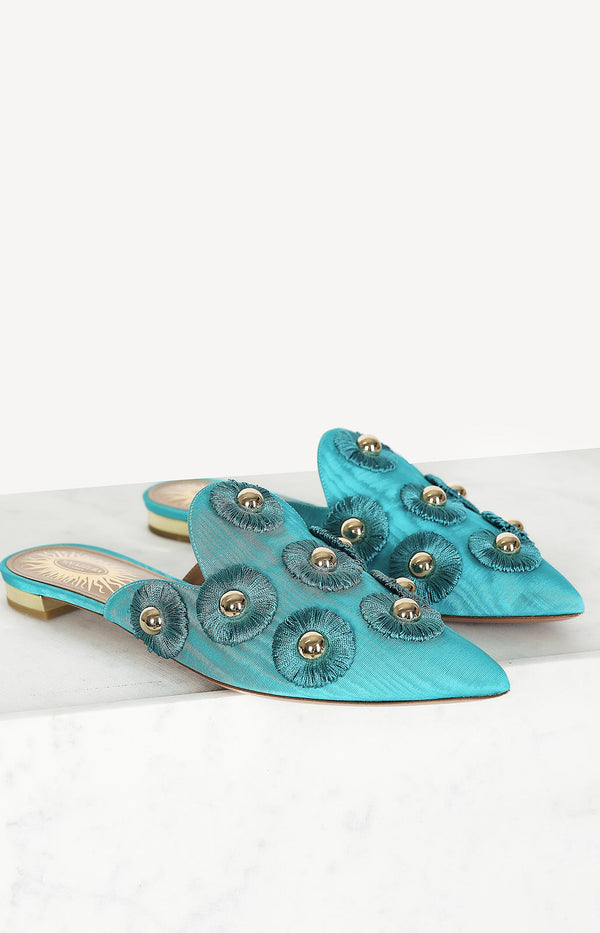 Turquoise mules with gold details