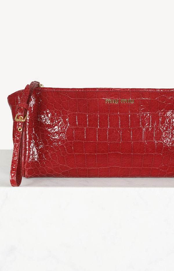 Crocodile embossed clutch in red