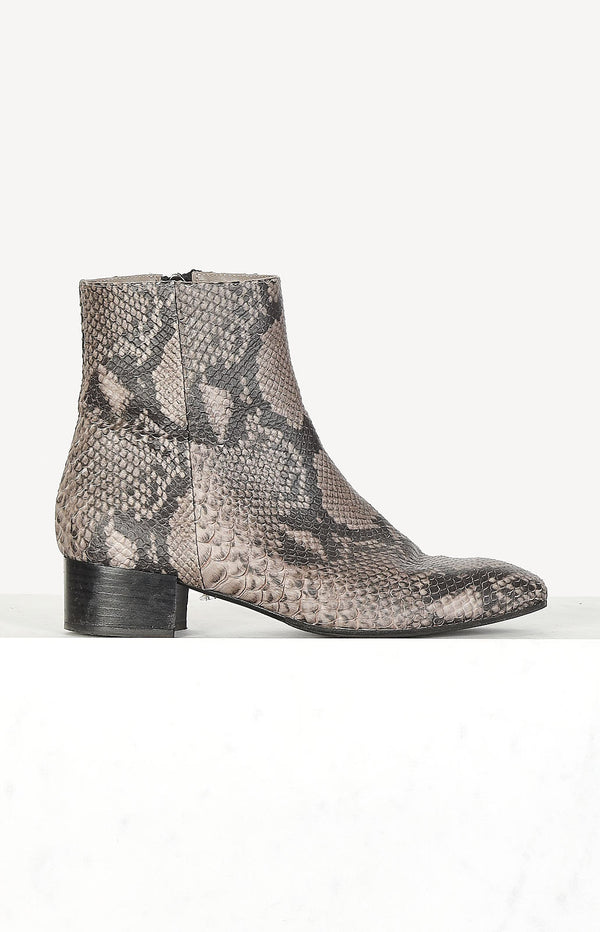 Exclusive snake print boots