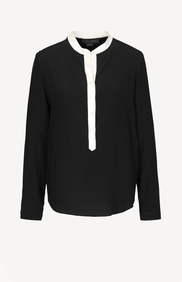 Black silk blouse with white details