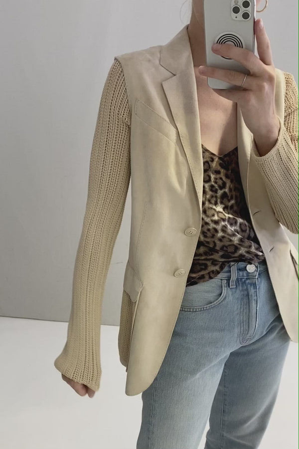 Leather blazer with knitted sleeves