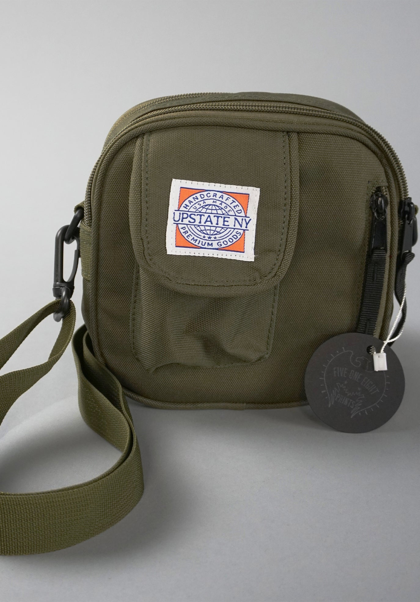 Essentials bag in olive green, showing detail of bag structure and custom Upstate NY sewn-on patch.