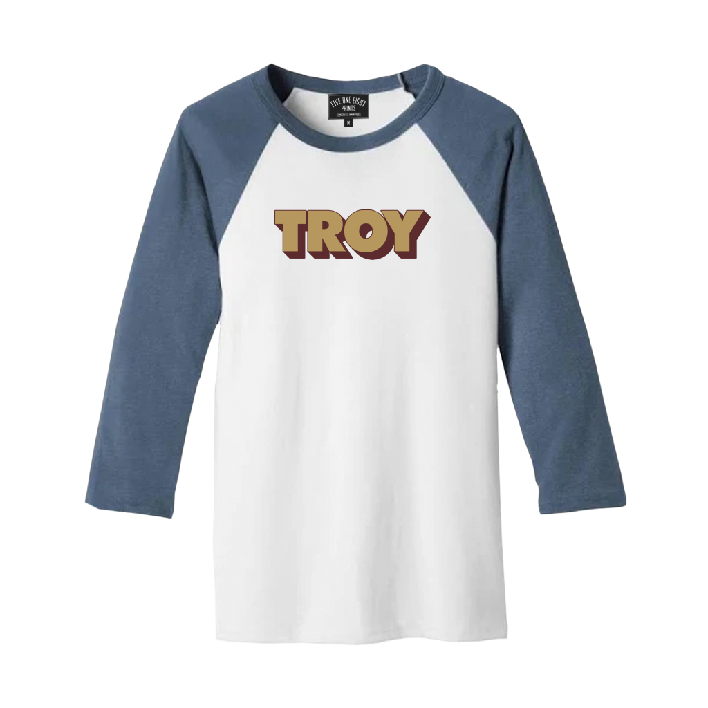 "Retro-stylish and comfortable, our ""3D Troy"" design has been printed on the front of a lightweight raglan tee in white and denim.  Only Found at 518 Prints"