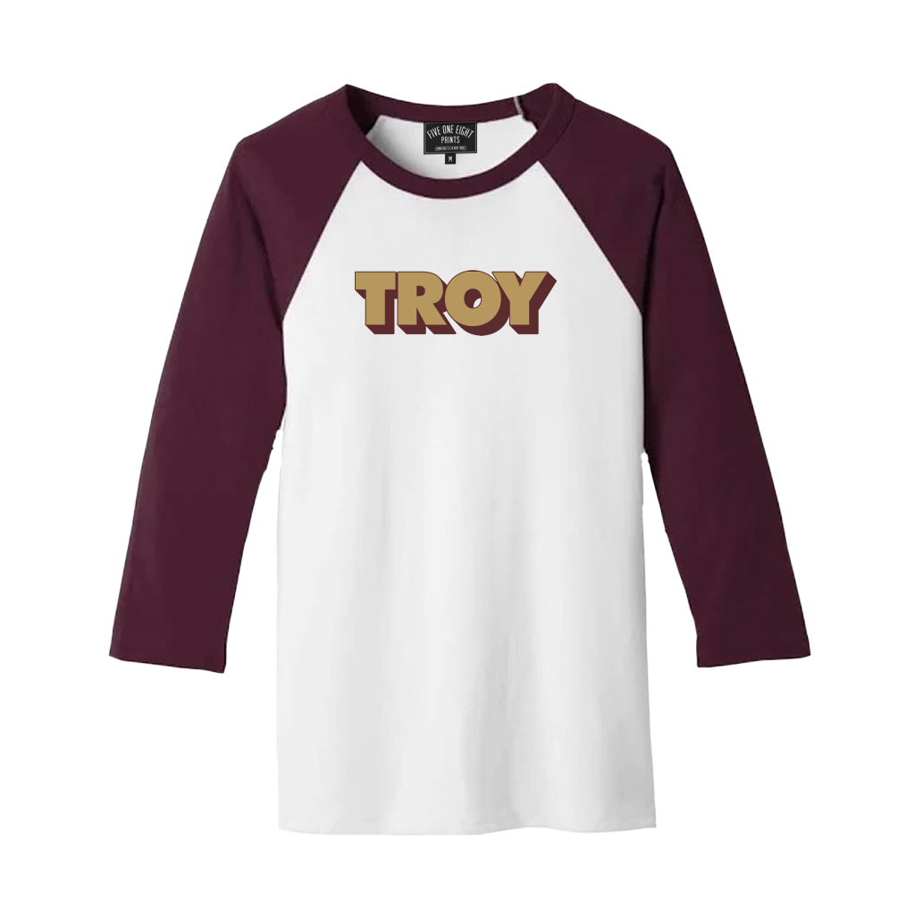 "Retro-stylish and comfortable, our ""3D Troy"" design has been printed on the front of a lightweight raglan tee in white and maroon.  Only Found at 518 Prints"