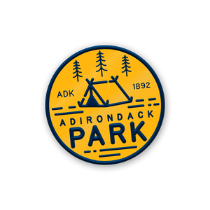 "Share your love of our great wilderness with our original design ADK Enamel Pin. Featuring the words ""ADK 1892"" (the year the Park was formally established) and ""Adirondack Park"" on a quality enamel pin.  Only Found at 518 Prints"