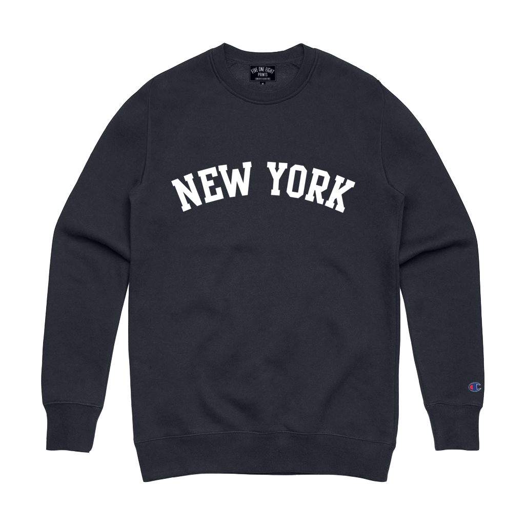 "Rep your state in our original ""New York Arch"" crewneck sweatshirt. This crew features white flocked print on a navy blue Champion Apparel sweatshirt.  Only Found at 518 Prints"