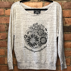 Grow where you're planted - and show off your resilient spirit in our comfortable flowy long sleeve. Custom design, printed in black on the front of a white marble colored shirt.  Only found at 518 Prints