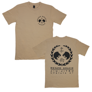 "Renzo Gracie Latham's ""Upstate Laurel"" design, printed on the front and back of a tan AS Colour tee.  Tee features include relaxed fit; crew neck; heavy weight, 6.5 oz, 22-singles; 100% combed cotton; neck ribbing; side-seamed; shoulder to shoulder tape; double-needle hems; preshrunk to minimize shrinkage."
