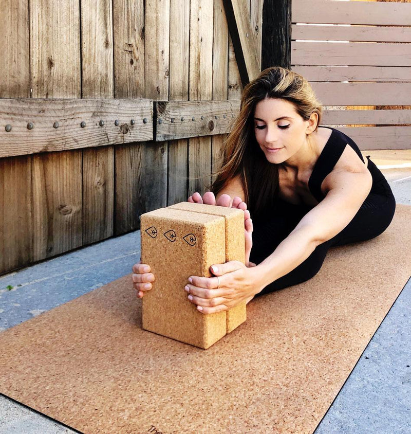 best cork yoga mat review why buy a cork yoga mat, benefits of yogamat cork, thick cork mat, the asanas, cork yoga block, yoga wheel, carrying strap for yoga mat forward fold